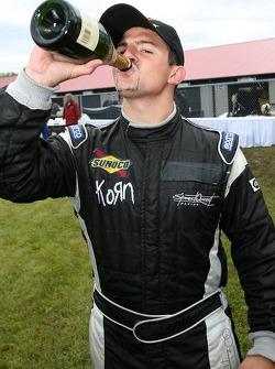Champagne pour Adam Pecorari