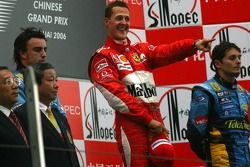 Podium: race winner Michael Schumacher with Fernando Alonso and Giancarlo Fisichella