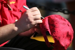A Bud Chevy crew member signs an autograph