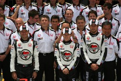Honda Racing F1 team photo: Anthony Davidson, Jenson Button and Rubens Barrichello pose with Honda Racing F1 team member