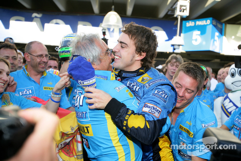 2006 F1 World Champion Fernando Alonso celebrates with Flavio Briatore