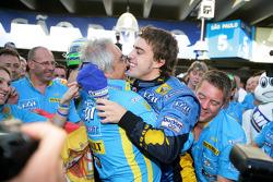 2006 F1 World Champion Fernando Alonso celebrates with Flavio Briatore