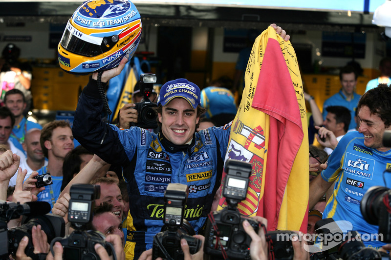 2006 F1 World Champion Fernando Alonso celebrates with Renault F1 team members