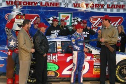 Brian Vickers receives the $25,000 shot gun for winning the pole