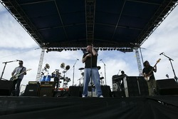 The music group Smash Mouth performs on stage