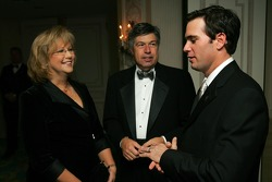 2006 NASCAR NEXTEL Cup Series champion, Jimmie Johnson, is congratulated by FOX broadcaster Mike Joy and his wife Gaye Joy