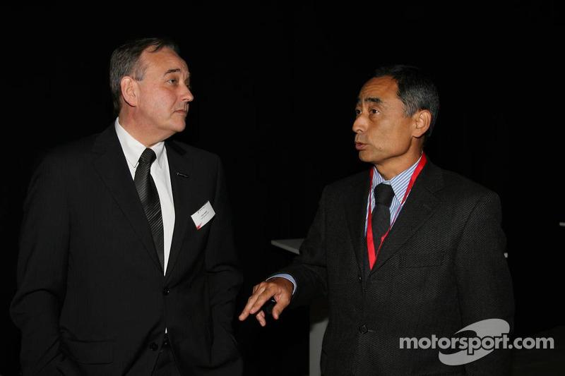 John Howett, Toyota Racing, President TMG and Hiroshi Yasukawa, Bridgestone