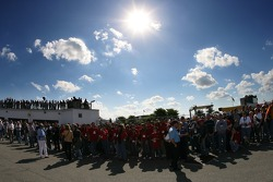 Fans watch the cars being rolled to the pre-grid