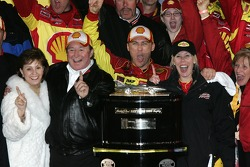 Victory lane: race winner Kevin Harvick celebrates with wife DeLana and team owner Richard Childress