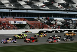 Jamie McMurray leads a group of cars
