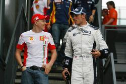 Kimi Raikkonen, Scuderia Ferrari et Alex Wurz, Williams F1 Team
