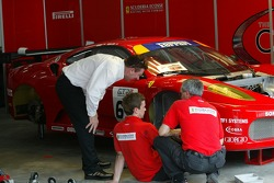Scuderia Ecosse team members at work
