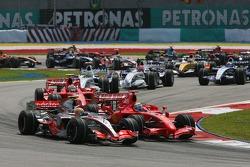 Lewis Hamilton, McLaren Mercedes, MP4-22 and Felipe Massa, Scuderia Ferrari, F2007 at the start of the race