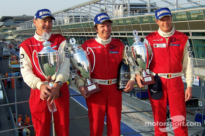 LMP2 podium: class winners Fredy Lienhard, Didier Theys and Eric van de Poele