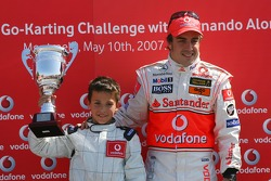 Vodafone Spain Go-Karting Challenge: Fernando Alonso, McLaren Mercedes, with a young Go-Karter