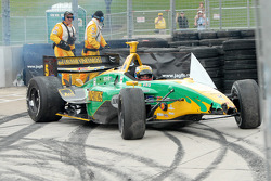 Safety crew retrieves Will Power from turn six runoff