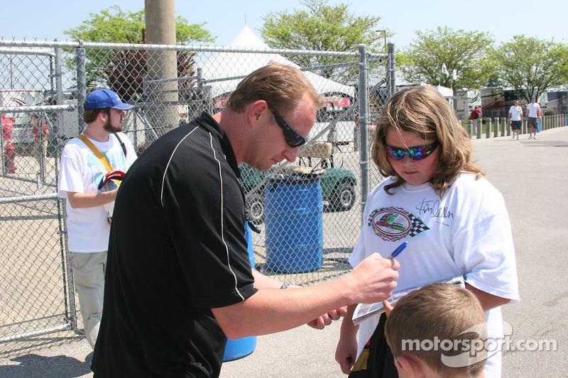Jaques Lazier signs an autograph