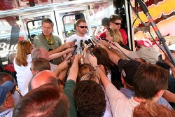 Dale Earnhardt Jr. speaks with members of the media at his hauler following practice