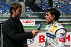 Bruno Spengler, Team HWA AMG Mercedes, being interviewed for ARD television