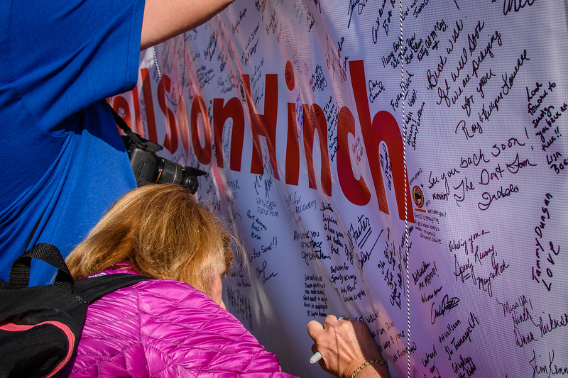 Fans sign a #GetWellHinch banner