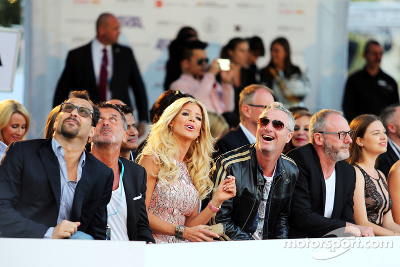Eddie Irvine, with Rachel Hunter, at the Amber Lounge Fashion Show