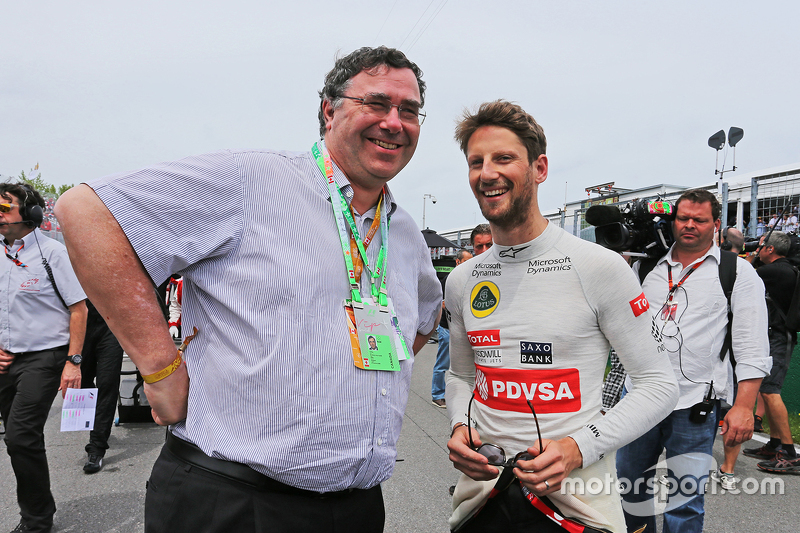Patrick Pouyanne, President and CEO Total SA, with Romain Grosjean, Lotus F1 Team on the grid