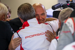 Dr. Wolfgang Ullrich of Audi Sport Team Joest congratulates Fritz Enzinger, Head of LMP1 Porsche Team, following their Le Mans victory