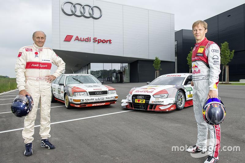 Hans-Joachim Stuck with Mattias Ekström celebrating a throwback livery celebrating Audi's debut DTM