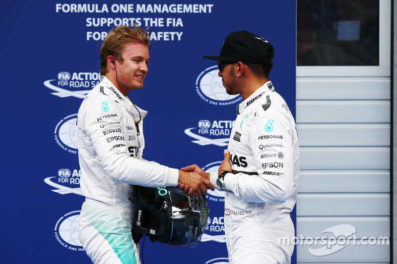 Second placed Nico Rosberg, Mercedes AMG F1 with team mate Lewis Hamilton, Mercedes AMG F1, who took pole position