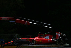 The Ferrari SF15-T of Kimi Raikkonen, Ferrari is recovered back to the pits on the back of a truck