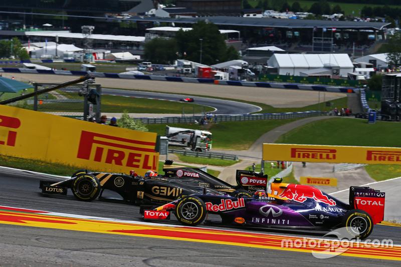 (L to R): Romain Grosjean, Lotus F1 E23 and Daniil Kvyat, Red Bull Racing RB11 battle for position