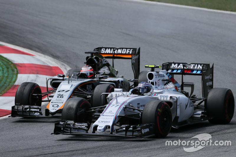 Valtteri Bottas, Williams FW37 and Nico Hulkenberg, Sahara Force India F1 VJM08 battle for position