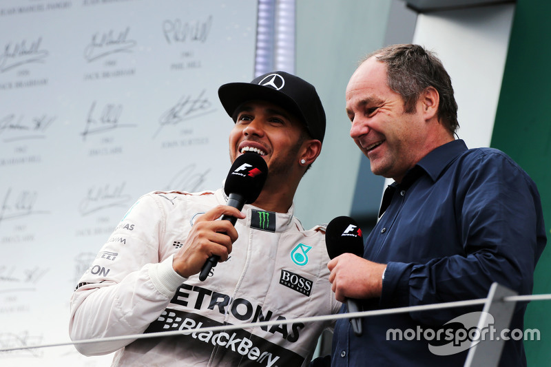 second placed Lewis Hamilton, Mercedes AMG F1 on the podium with Gerhard Berger