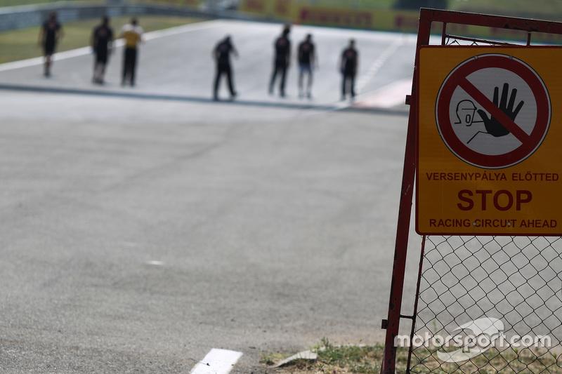 Stop - Racing Circuit Ahead' warning sign