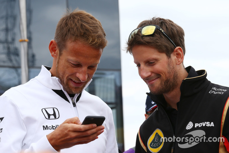 (L to R): Jenson Button, McLaren with Romain Grosjean, Lotus F1 Team on the drivers parade