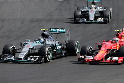 Nico Rosberg, Mercedes AMG F1 Team en Kimi Raikkonen, Scuderia Ferrari