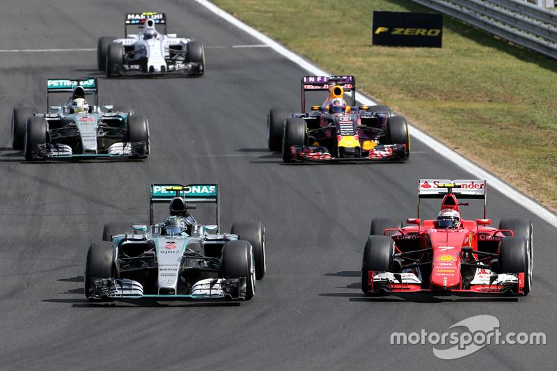 Нико Росберг, Mercedes AMG F1 Team и Кими Райкконен, Scuderia Ferrari