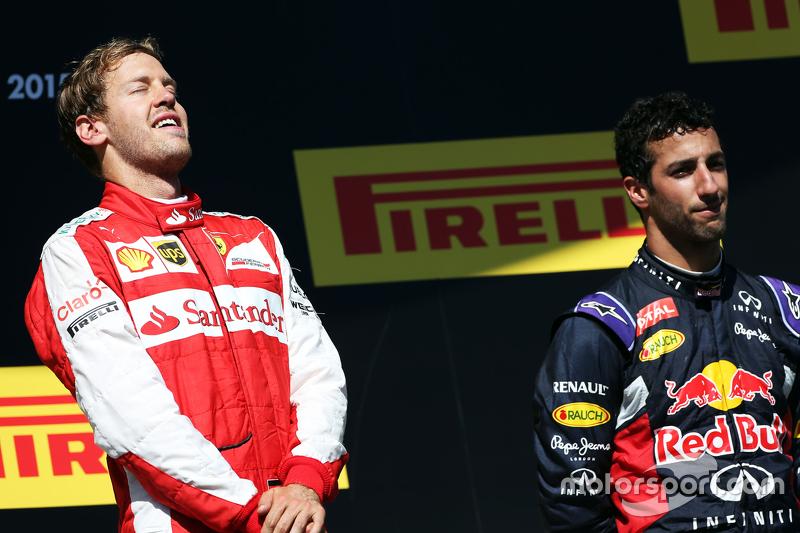 Race winner Sebastian Vettel, Ferrari celebrates on the podium with Daniel Ricciardo, Red Bull Racin