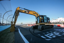 Race winner Joey Logano, Team Penske assists with the start of repaving work