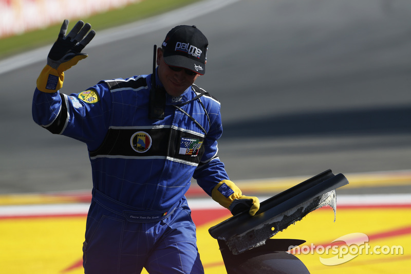 Marshal collects debris on track