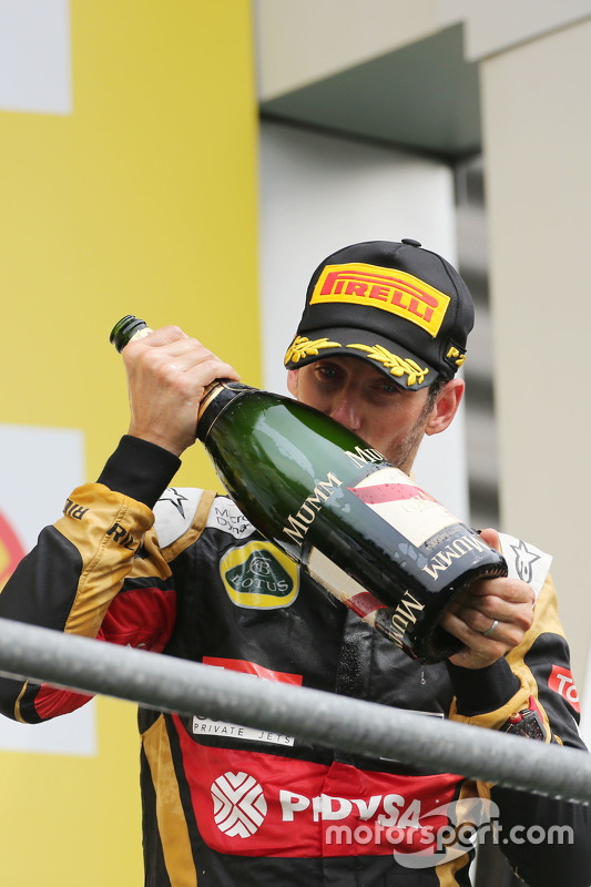 Romain Grosjean, Lotus F1 Team celebrates his third position on the podium