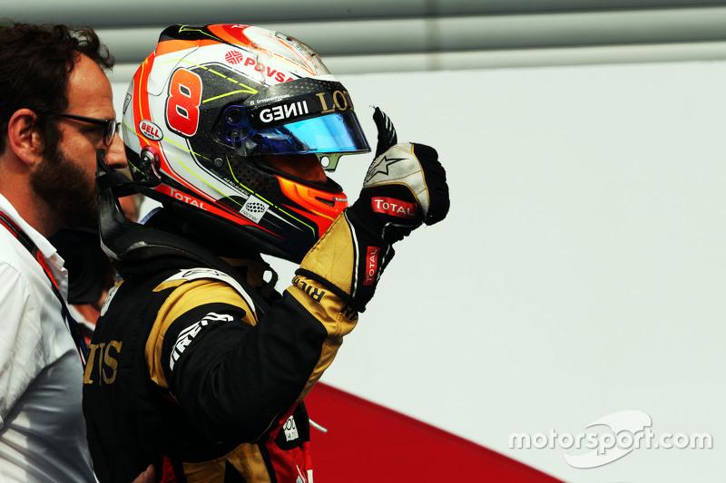 Romain Grosjean, Lotus F1 Team celebrates his third position in parc ferme