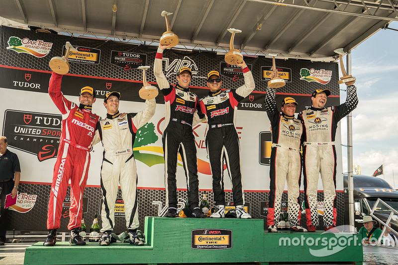 Podium: Race winners #17 RS1 Porsche Cayman: Spencer Pumpelly, Luis Rodriguez Jr., second place #56