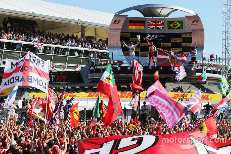(L to R): Race winner Lewis Hamilton, Mercedes AMG F1 and second placed Sebastian Vettel, Ferrari celebrate on the podium