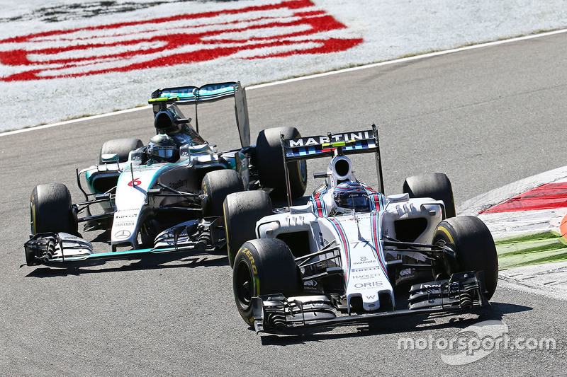 Valtteri Bottas, Williams FW37 and Nico Rosberg, Mercedes AMG F1 W06 battle for position