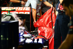 Pirelli engineers remove the damaged rear tyre of Carlos Sainz Jr., Scuderia Toro Rosso STR10 in the second practice session