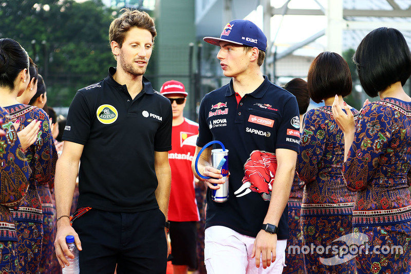 Romain Grosjean, Lotus F1 Team, mit Max Verstappen, Scuderia Toro Rosso, bei der Fahrerparade