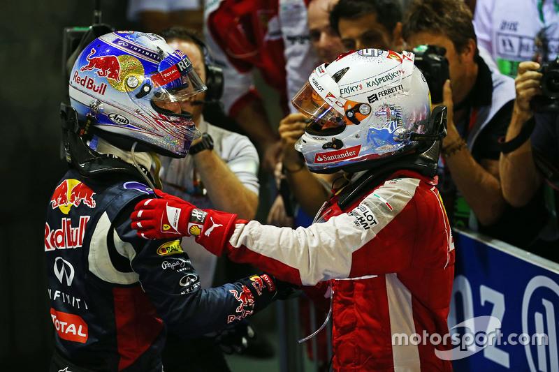 Race winner Sebastian Vettel, Ferrari celebrates in parc ferme with second placed Daniel Ricciardo,