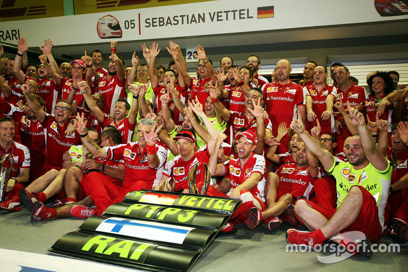 Race winner Sebastian Vettel, Ferrari and third placed Kimi Raikkonen, Ferrari celebrate with the te