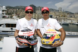Lewis Hamilton, McLaren Mercedes and Fernando Alonso, McLaren Mercedes, with Steinmetz Diamonds in their helmets